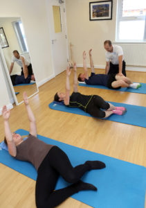 Dallas, group session, physiotherapy, legs, arm, exercises